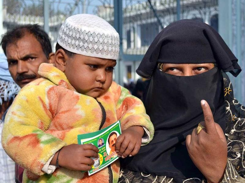 A Muslim woman with her son at the second phase of assembly elections, in Mau town in Uttar Pradesh. HT Photo/Ashish Srivastava