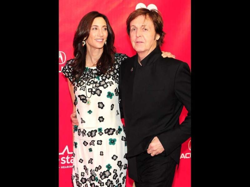 Paul McCartney and his wife Nancy Shevell arrive at the event.