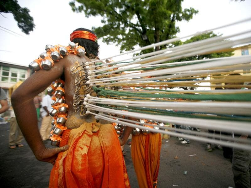 A Malaysian Hindu devotee walks with his back pierced with hooks attached to ropes during the Thaipusam festival in Georgetown. Picture taken on February 7, 2012. Reuters/Samsul Said