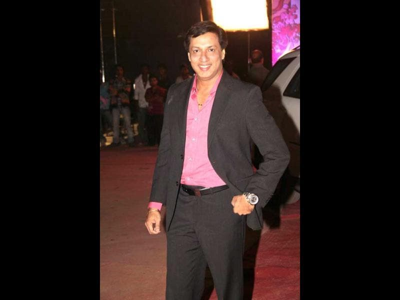 Madhur Bhandarkar looks cheerful.