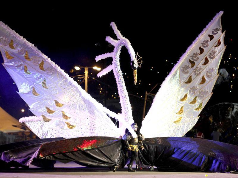 Brian Chin presents the theme Prince Sigfried: The Story Of Swan Lake-Tribute to Wayne Berkley, on the stage at Queen's Park Savannah during the preliminaries of the King and Queen of Carnival competition in Port of Spain. Twenty semi-finalists were chosen from the 74 competitors from each of the king and queen categories, to go on to the next round. REUTERS/Andrea De Silva