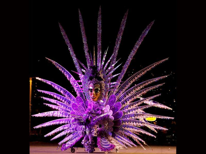 Kay Mason presents a creation titled Amethyst Rising, on the stage at Queen's Park Savannah during the preliminaries of the King and Queen of Carnival competition in Port-of-Spain. Twenty semi-finalists were chose from the 74 competitors from each of the king and queen categories, to go on to the next round. REUTERS/Andrea De Silva