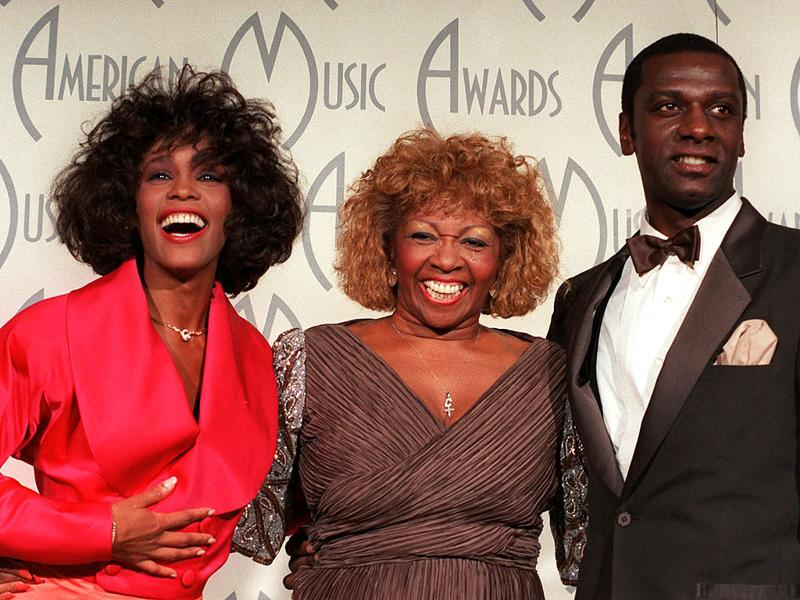Whitney Houston, celebrates her win at the American Music Awards with her mother, Cissy, and brother, Gary, at the Shrine Auditorium, in Los Angeles. File AP photo/Reed Saxon