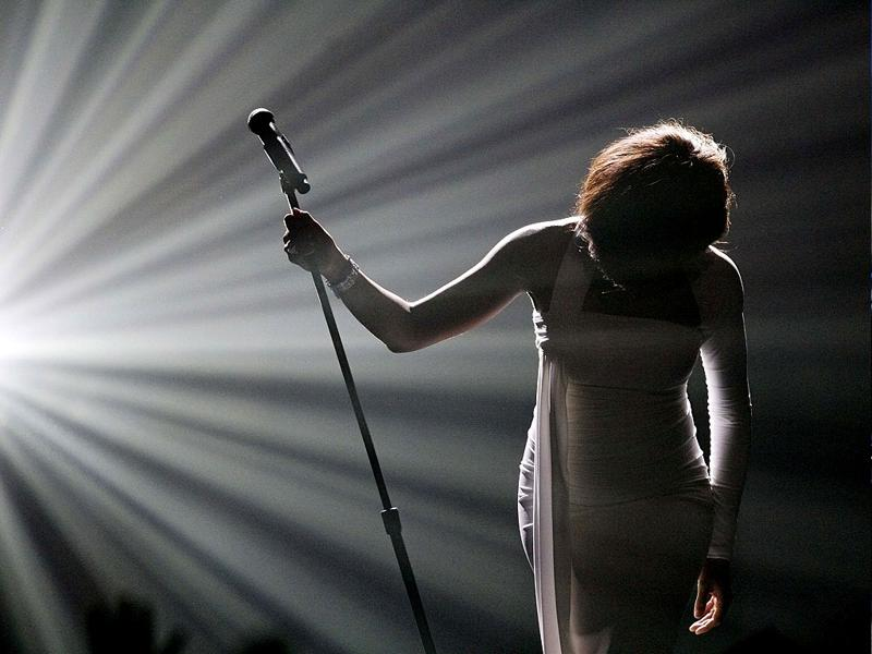 Whitney Houston bows after performing