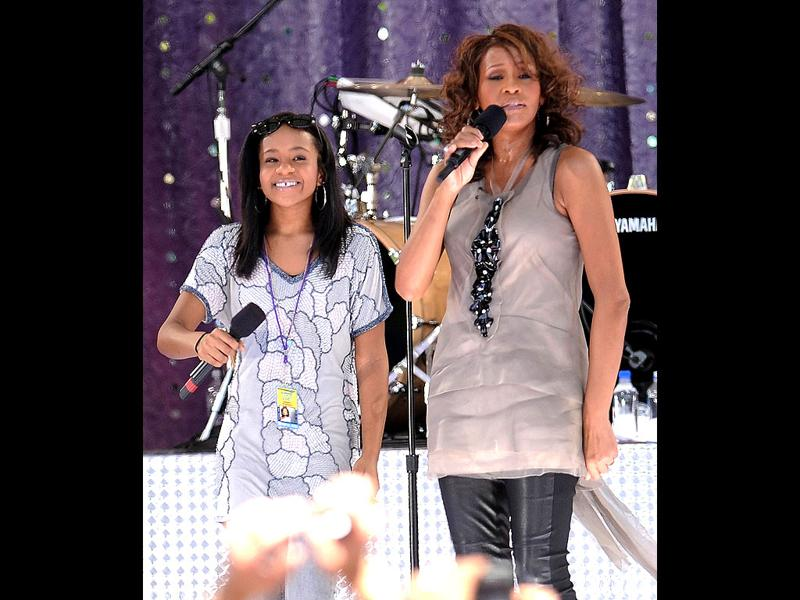 Whitney Houston sings with her daughter Bobbi Kristina Brown during a performance on Good Morning America in Central Park in New York. (AP Photo)