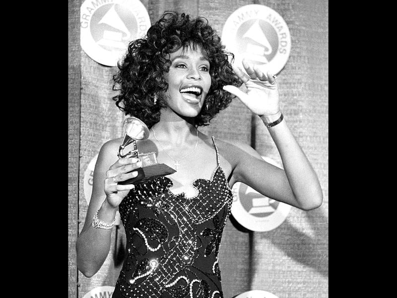 Whitney Houston poses with her Grammy after she was named Best Pop Vocal Performer - Female at the 30th annual Grammy Awards at New York's Radio City Music Hall in this March 2, 1988 file photo. REUTERS/Mark Peterson