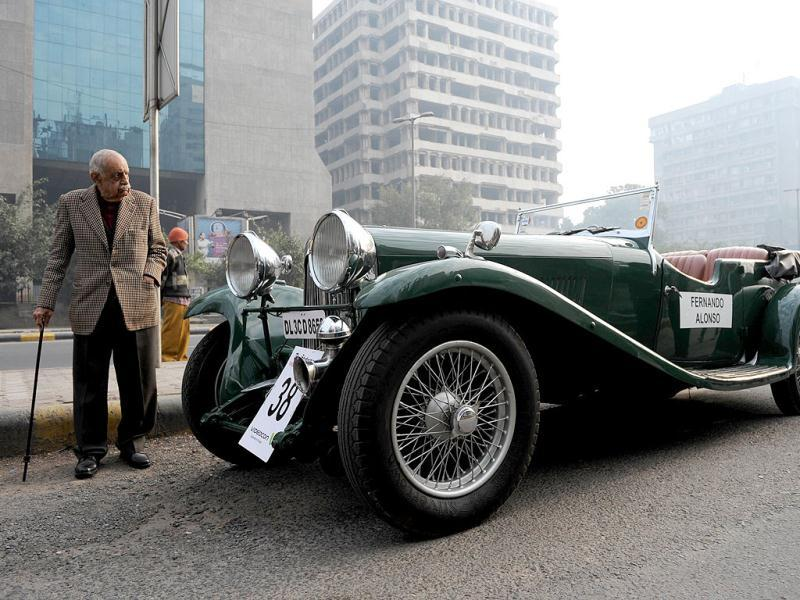 A visitor inspects a Lagonda during a vintage car parade in New Delhi. More than sixty vintage automobiles were on display and flagged off during the 46th car rally, organised by a local newspaper. (AFP Photo)