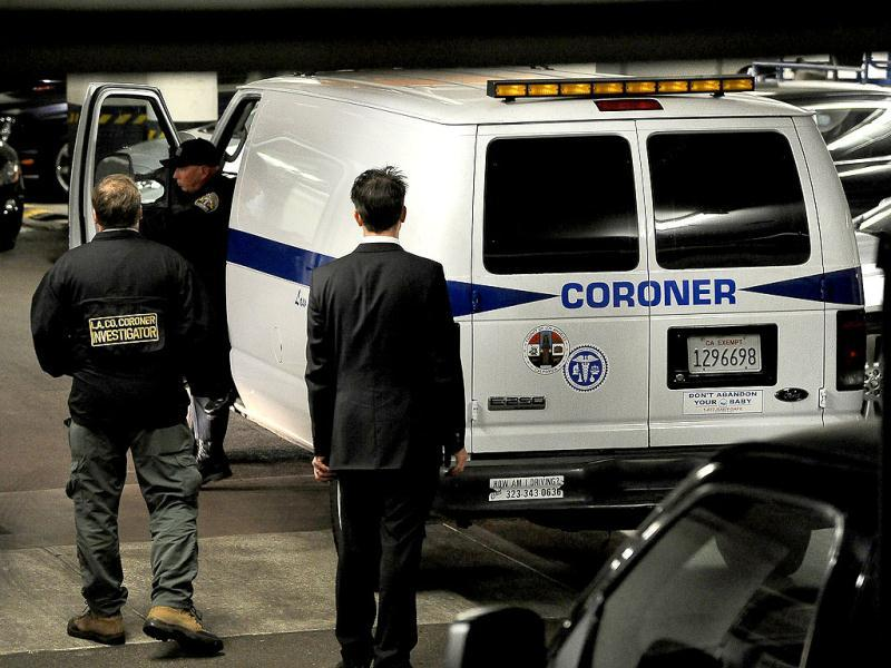 Officials from the Los Angeles County corroner office arrive at the Beverly Hilton Hotel in Beverly Hills where singer Whitney Huston was found dead. The shock news came as the music industry gathered in Los Angeles for the annual Grammy awards show on Sunday, and a few hours ahead of a traditional pre-Grammys dinner in the hotel where Houston died. (AFP Photo)