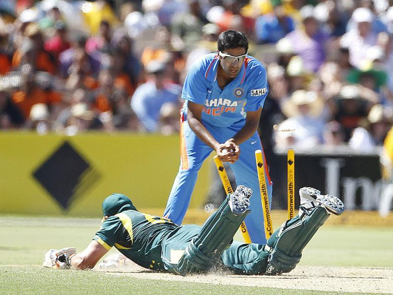Australia's Peter Forrest slides to make his ground as Ravichandran Ashwin attempts to run him out during their one-day international cricket match in Adelaide. Reuters photo