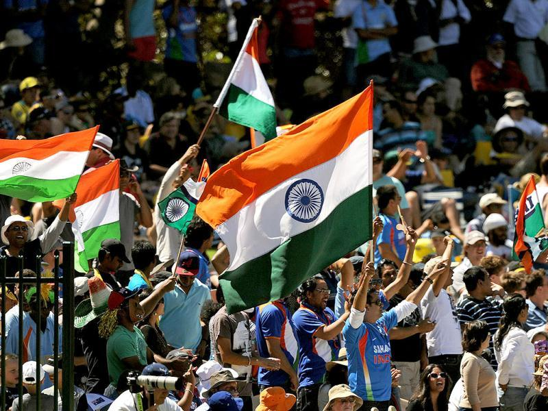 Indian fans celebrate the dismissal of Australia's Michael Clarke during their one-day international cricket match in Adelaide. AFP Photo