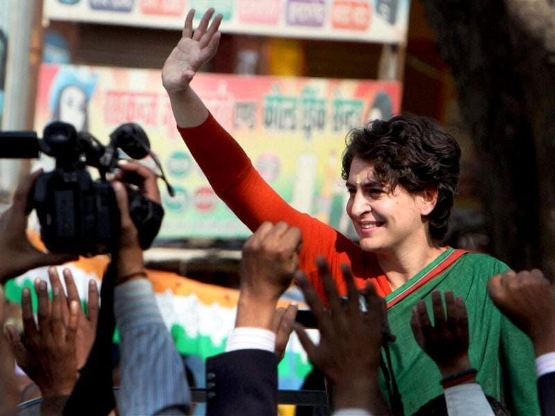 Priyanka Gandhi Vadra waves at the crowd during an election campaign in Tyary. PTI Photo/Atul Yadav
