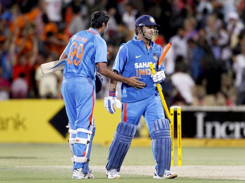 MS Dhoni (R) is congratulated by Ravichandran Ashwin after they won their one-day international cricket match against Australia in Adelaide. Reuters Photo/Tim Wimborne