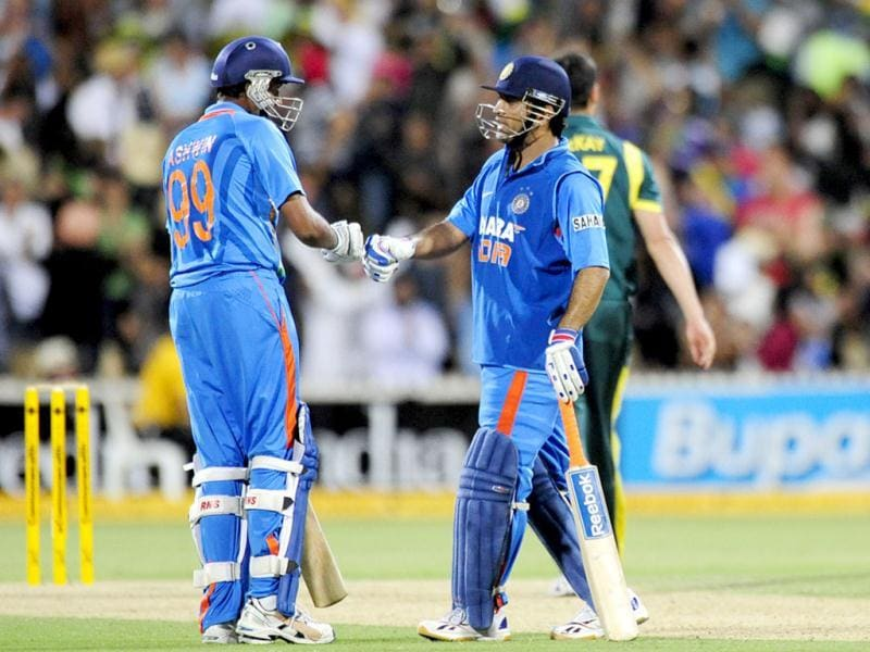 Ravichandran Ashwin, left, and MS Dhoni during their One Day International series cricket match against Australia in Adelaide. AP Photo/David Mariuz