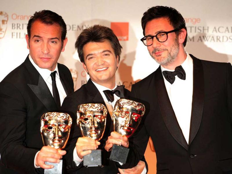 The Artist crew with their awards: (L-R) Actor Jean Dujardin, Producer Thomas Langmann, Director Michel Hazanavicius.
