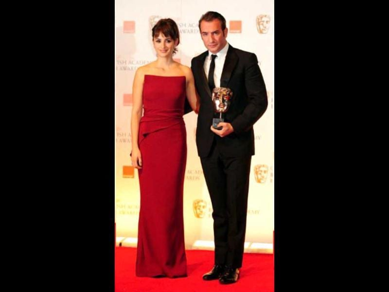 Best Actor award presenter poses Penelope Cruz with the winner Jean Dujardin for his film The Artist.