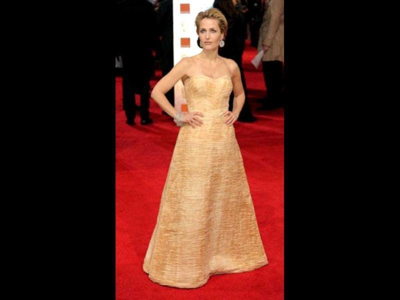 X Files actor Gillian Anderson poses at the Bafta red carpet.