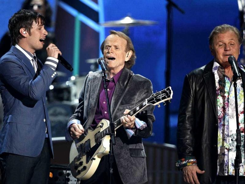 Mark Derek Foster of the band Foster the People, Al Jardine and Bruce Johnston of the band Beach Boys perform during the music awards.