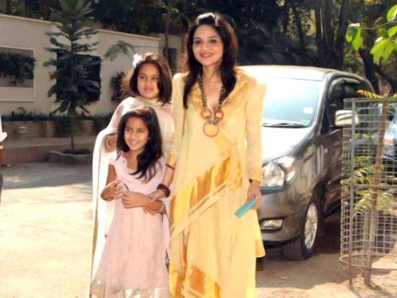 Former actor Madhu Shah poses with daughters.
