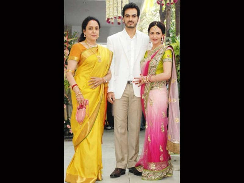 Hema Malini poses with daughter Esha Deol and son-in-law Bharat Takhtani at the duo's engagement.