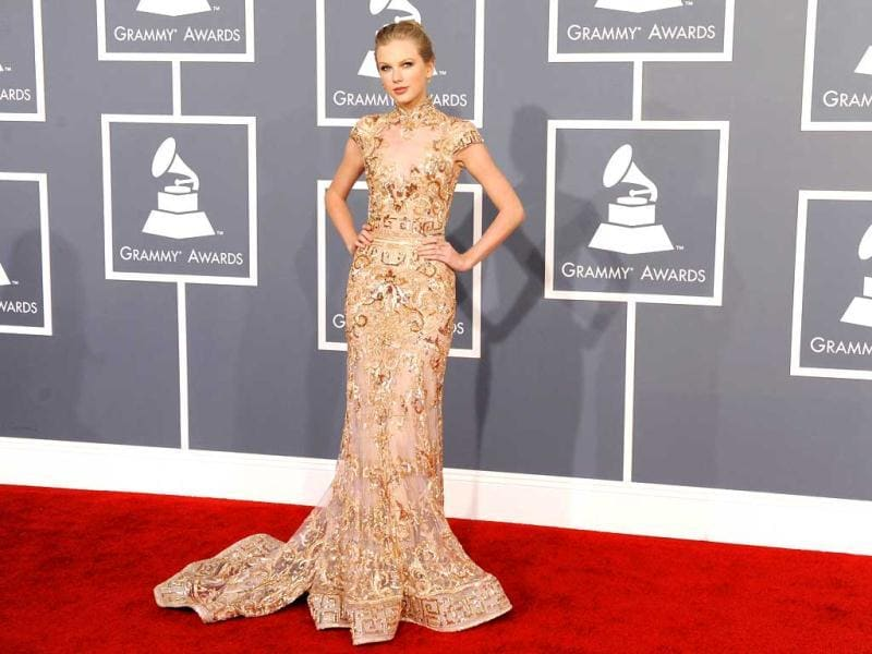 Taylor Swift looks pretty but too skinny in her embellished gown.