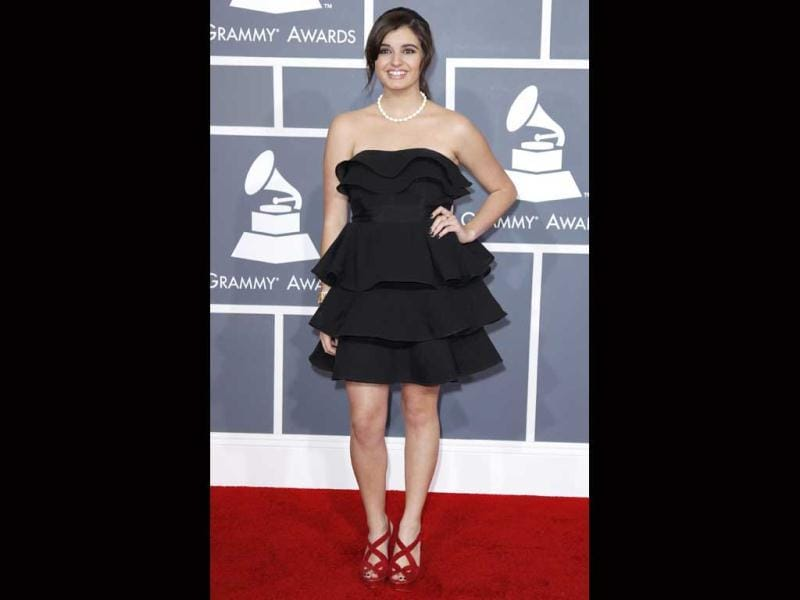 Rebecca Black looks outdated in a black frill dress.
