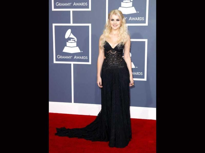 Mika Newton looks pretty in a black gown with plunging neckline.