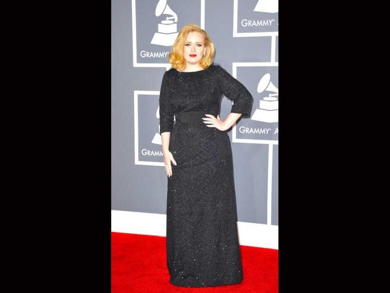 Adele sported a classic look in a long black beaded gown.