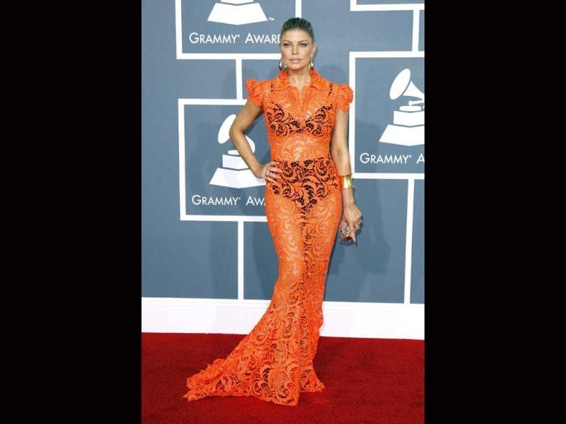 Fergie wore a bright orange peek-a-boo Jean Paul Gaultier gown revealing black bra and panties beneath. She looked absolutely hideous and insulted the pretty gown.