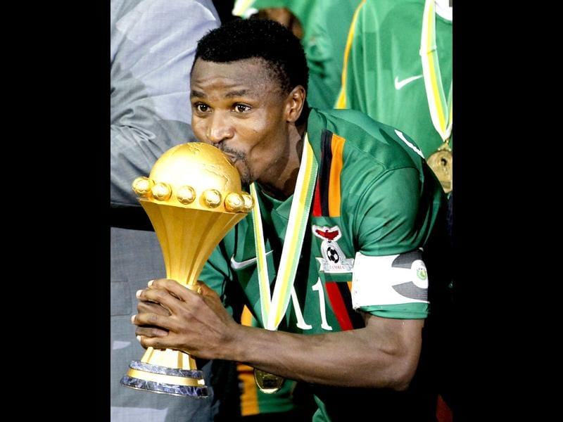 Zambia's captain Christopher Katongo kisses the trophy after winning the 2012 African Cup of Nations tournament's final match against Ivory Coast at the Stade De L'Amitie Stadium in Gabon's capital Libreville. REUTERS/Thomas Mukoya