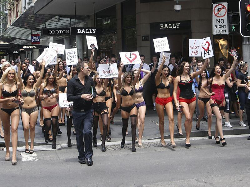 Women march through downtown Sydney demanding lingerie themed Valentine's Day gifts during a rally sponsored by a lingerie company in Australia. (AP Photo/Rob Griffith)