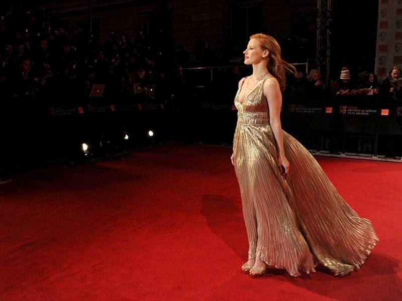 Jessica Chastain looks grand in a gold Oscar De La Renta gown.