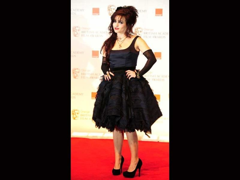 Helena Bonham Carter is seen once again in her signature unkempt and ruffled up look.