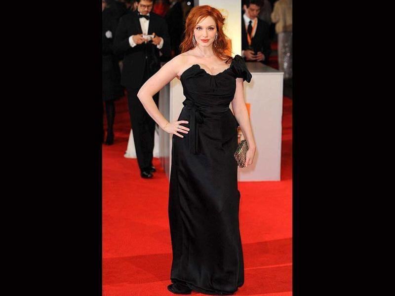 Christina Hendricks' hourglass figure looks a tad toned down thanks to the black gown.
