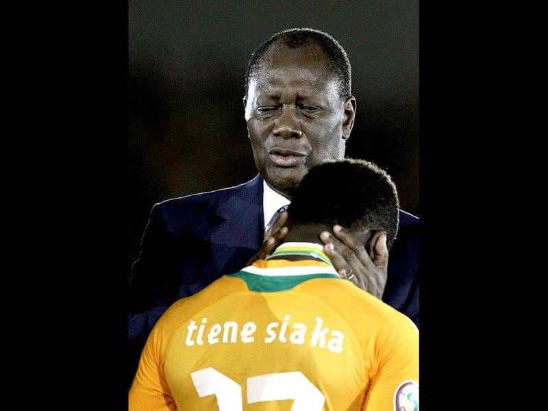 Ivory Coast President Alassane Ouattara consoles player Siaka Tiene after Ivory Coast's loss to Zambia in their African Cup of Nations final soccer match at Stade de l'Amitie in Libreville, Gabon. (AP Photo/Rebecca Blackwell)
