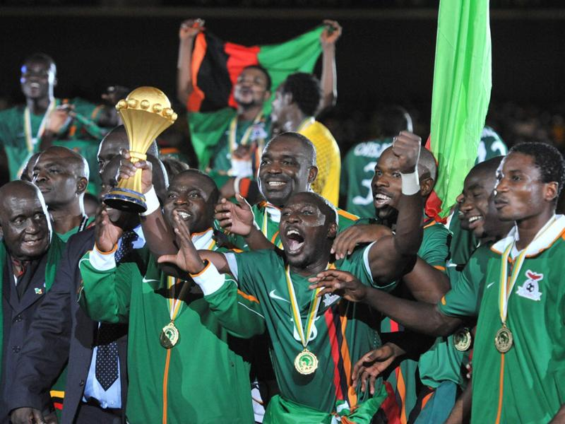Zambia's national football team players celebrate with cup after their victory against Ivory Coast at the Stade de l'Amitie in Libreville after the Africa Cup of Nations (CAN 2012) final. Zambia conjured up a shock when they toppled star-studded Ivory Coast 8-7 in a penalty shoot-out to claim their first ever Africa Cup of Nations title. AFP Photo/Issouf Sanogo