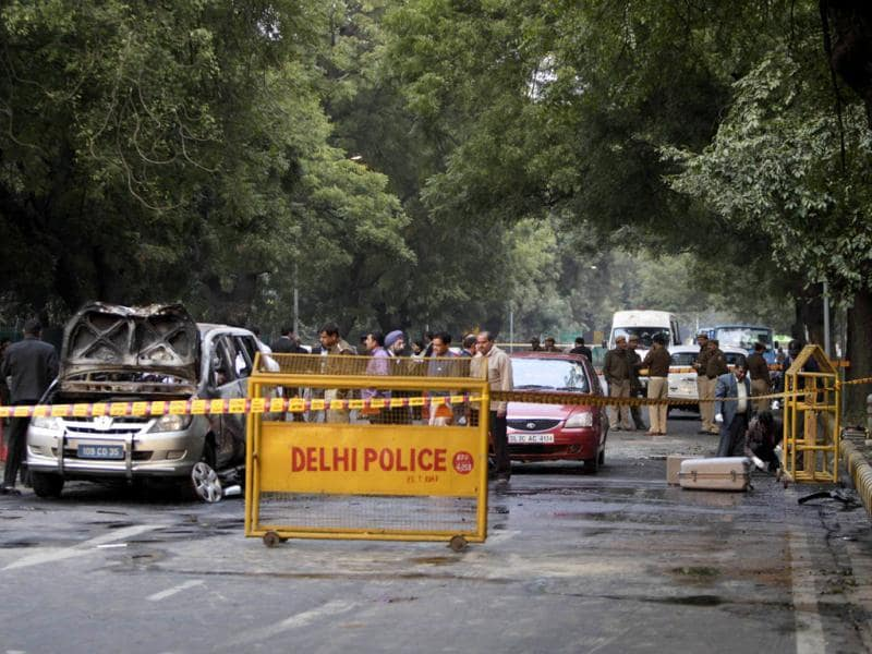 Security and forensic officials examine a car belonging to the Israel embassy, left, after an explosion tore through that in New Delhi. AP/Mustafa Quraishi