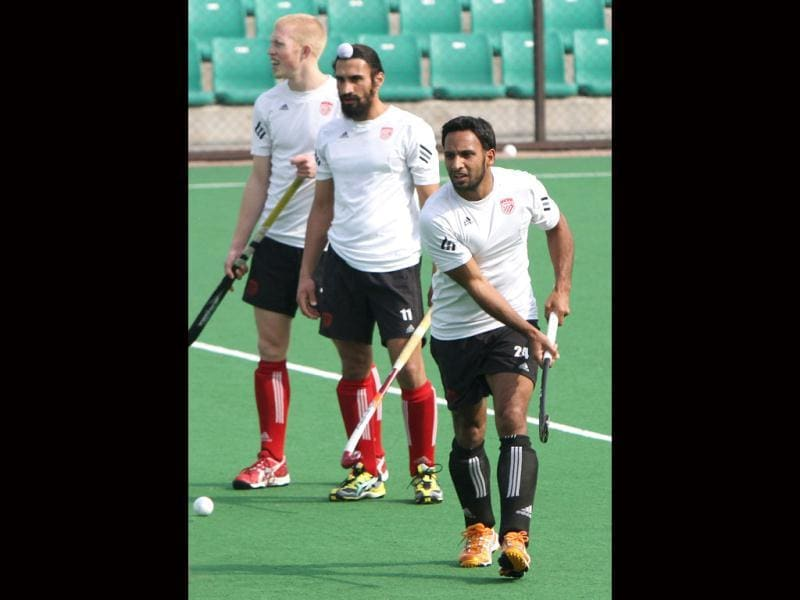 Canada's Sukhwinder Gabbar Singh and Jagdish Gill during the practice ahead of up coming Olympic qualifier matches at national stadium in New Delhi. HT photo by Mohd Zakir