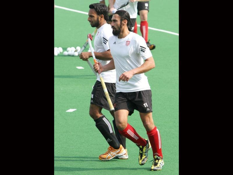 Canada's hockey team members Sukhwinder Gabbar Singh (front) and Jagdish Gill during the practice ahead of up coming Olympic qualifier matches at national stadium in New Delhi. HT photo by Mohd Zakir