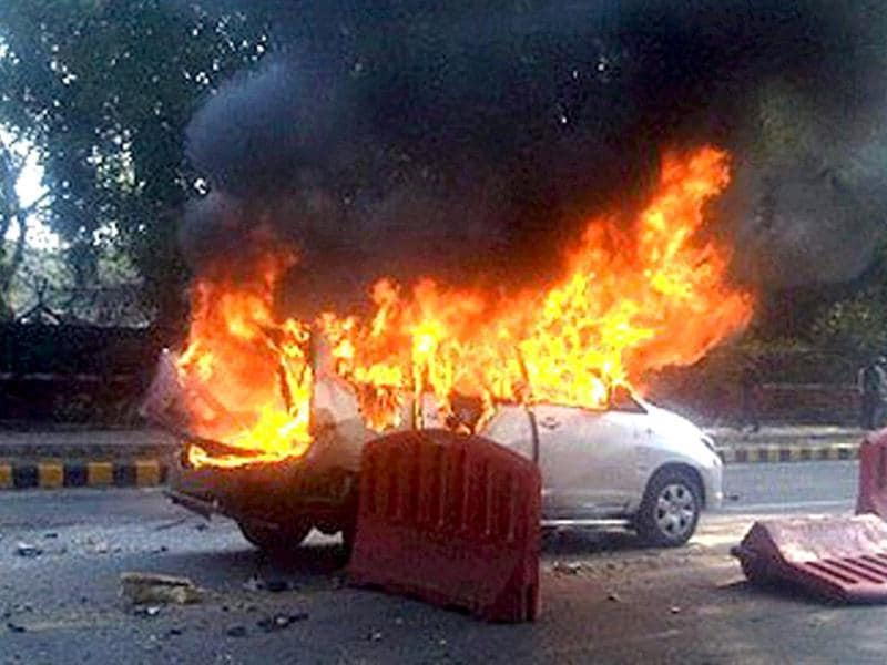 An Israeli embassy car up in flames after a blast in New Delhi. PTI Photo