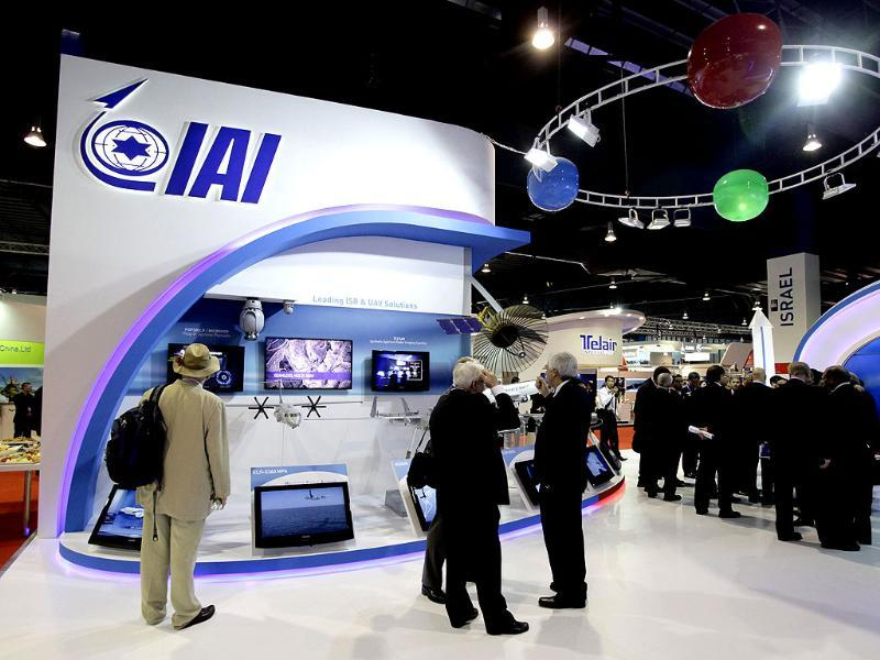 Trade visitors gather at the Israel Aerospace Industries (IAI) exhibition booth at the Singapore Airshow. Reuters/Tim Chong