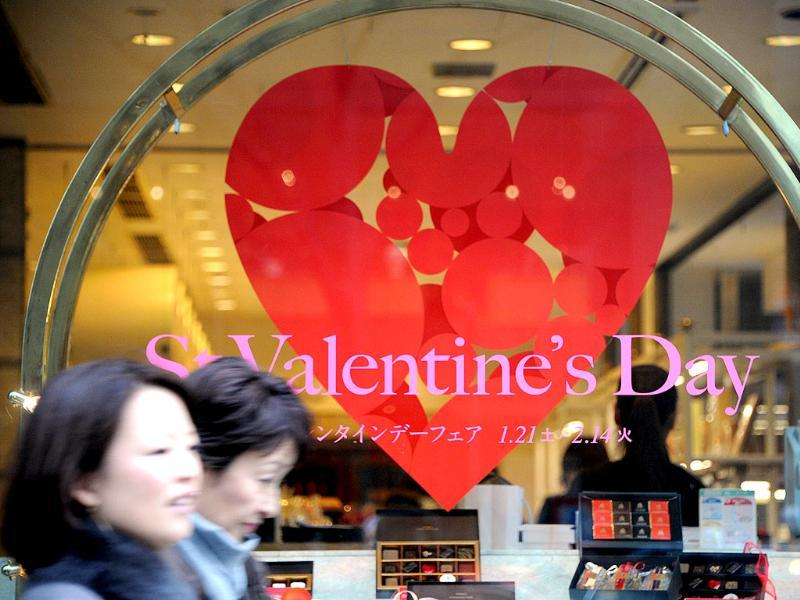 Passers by walk in front of a cake shop displaying a St. Valentine's Day announcement at the Ginza district in Tokyo. AFP photo/Toshifumi Kitamura
