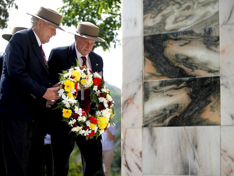 Australian World War II veterans, William Ennis (L) and Gordon Butler who survived the Battle of Gemas, lay a wreath during a commemoration of the battle at a memorial in Gemas 170 km south of Kuala Lumpur. Reuters/Bazuki Muhammad