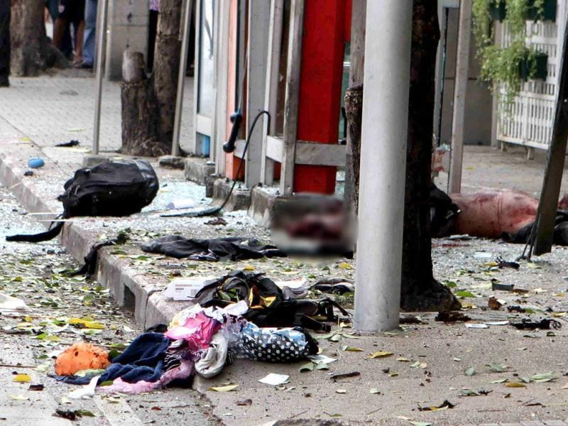 An injured man lies on the ground after a bomb he was carrying exploded, in Bangkok. (Reuters)