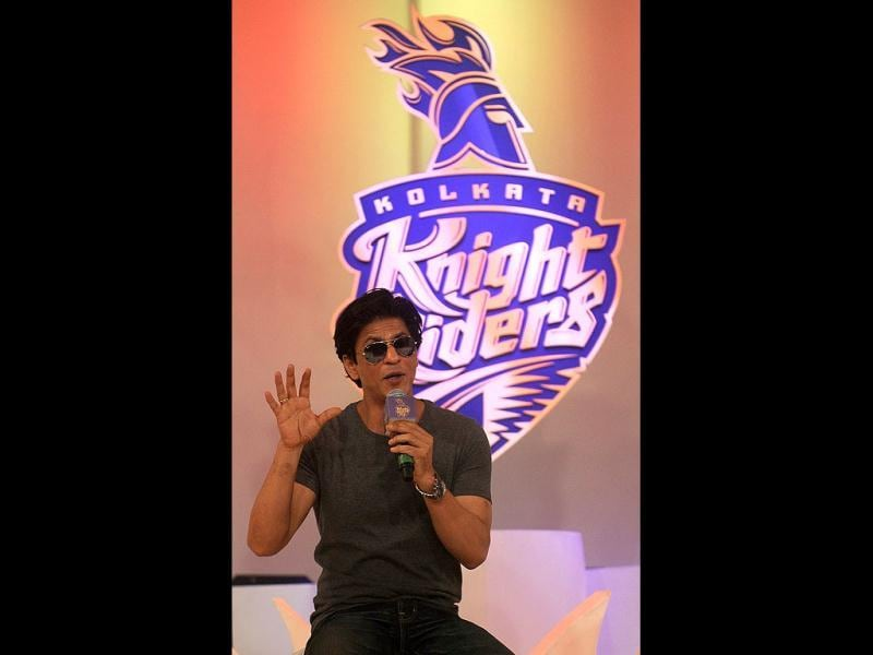 SRK addresses the media.