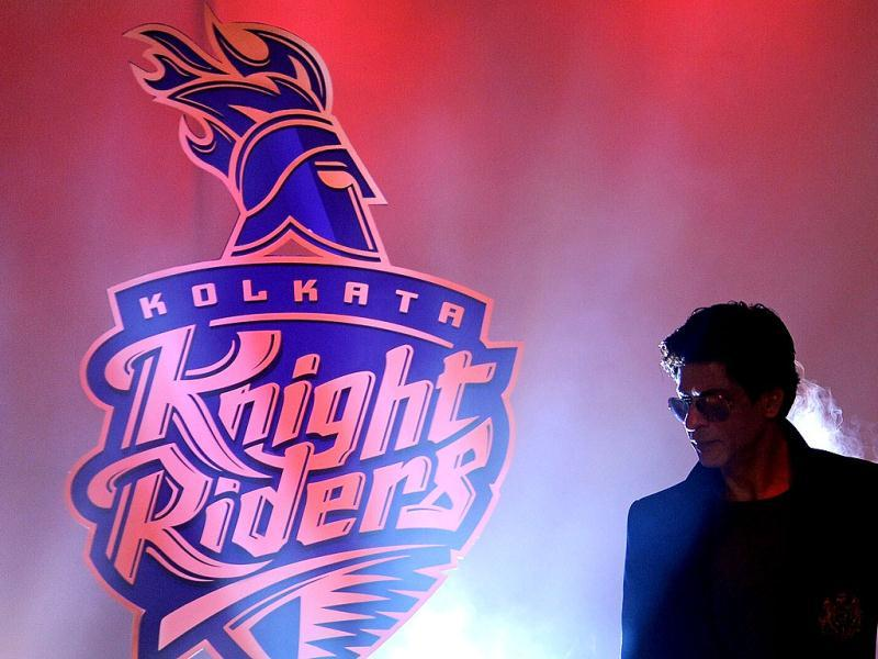 King Khan stylishly poses in front of the new KKR logo.