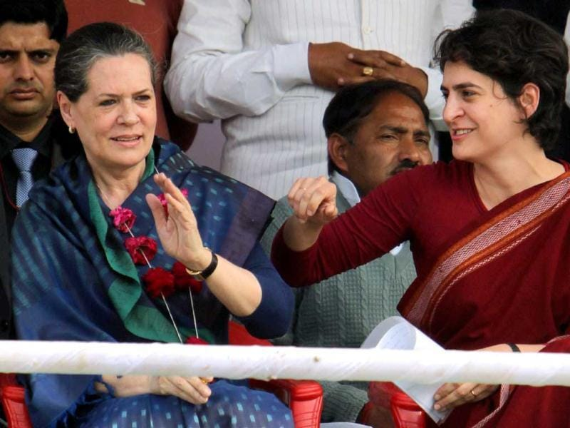 Priyanka Gandhi Vadra shares a lighter moment with her mother and UPA Chairperson Sonia Gandhi at an election campaign in rally in Raebareli. PTI Photo/Atul Yadav