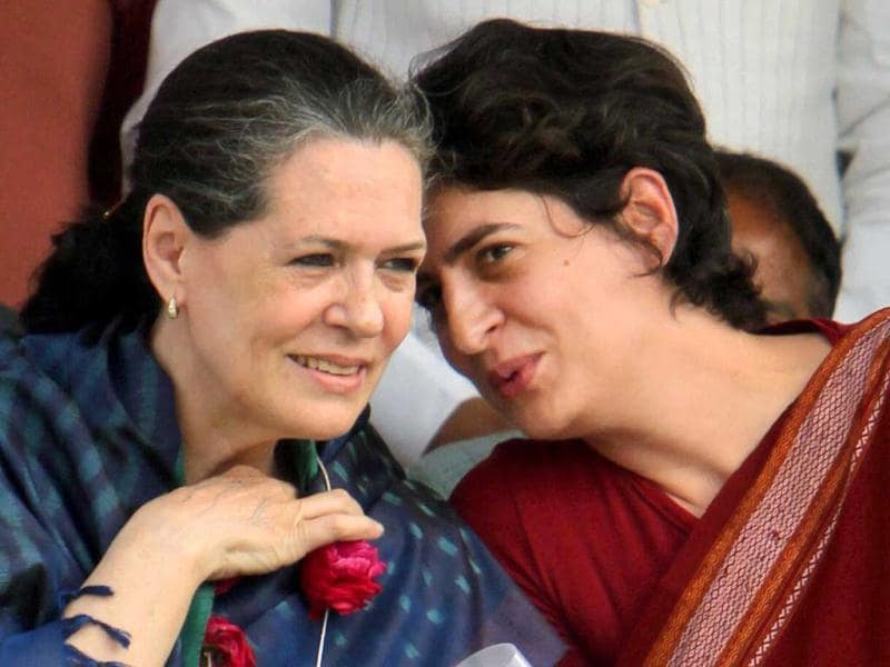 Priyanka Gandhi Vadra chats up with her mother and UPA Chairperson Sonia Gandhi at an election campaign in rally in Raebareli on Tuesday. PTI Photo by Atul Yadav