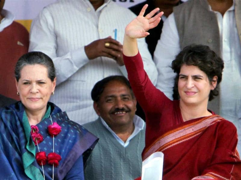 Priyanka Gandhi Vadra waves at an election campaign rally with her mother and UPA chairpaerson Sonia Gandhi in Raebareli. PTI Photo/Atul Yadav