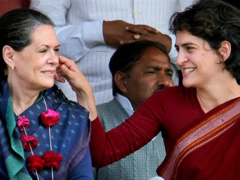 Priyanka Gandhi Vadra shares a lighter moment with her mother and UPA Chairperson Sonia Gandhi at an election campaign rally in Raebareli. PTI Photo