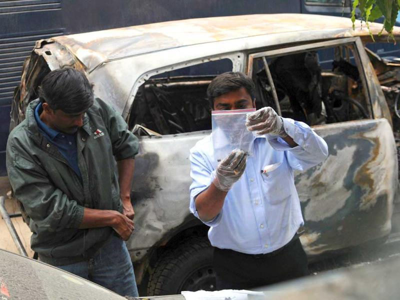 Special investigators inspect the vehicle that exploded February 13 near the Israeli embassy in New Delhi. AFP